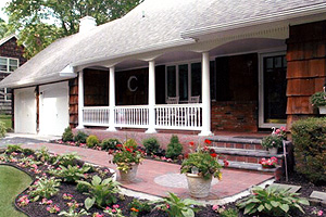 Long Island fence company uses versatile vinyl to construct beautiful porch railings.
